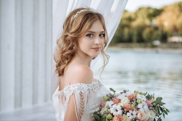 Smiling Russian bride in white dress
