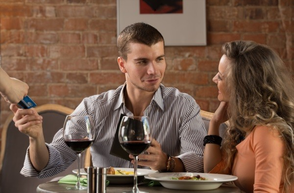 man paying the restaurant bill and showing generosity