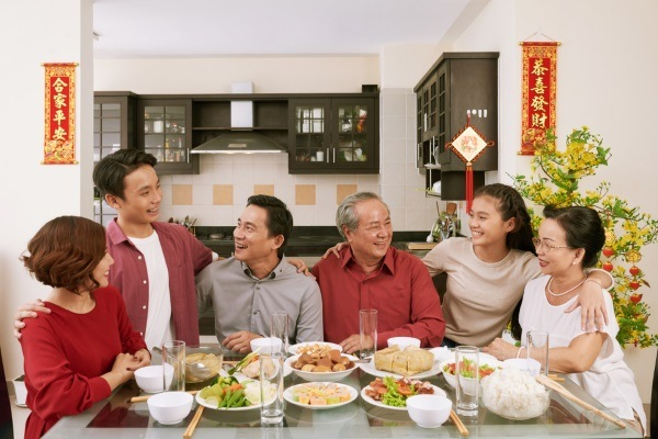 Asian family dinner gathering to meet new member