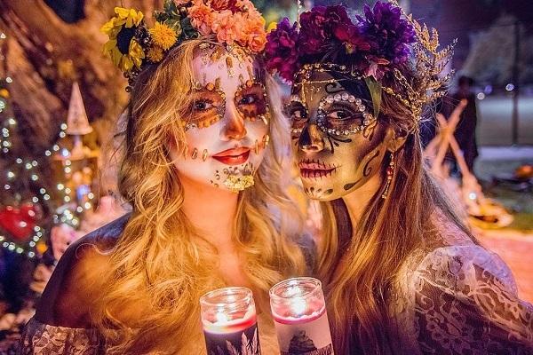 mexican women wearing skull makeup on a festival